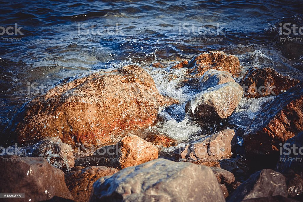 big wet rocks, splashing and shining sun stock photo