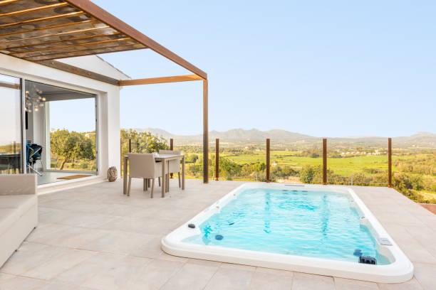 Big whirlpool in luxury hotel suite stock photo