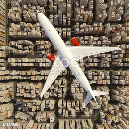 istock Big white airplane above the huge city. 613528862
