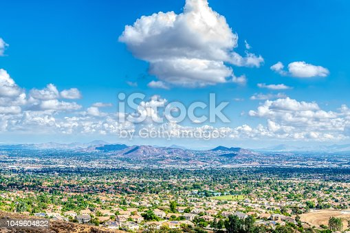 Beautiful sunny and cloudy day in Southern California mountains and suburbs with blue sky and white clouds from recent rain showers.