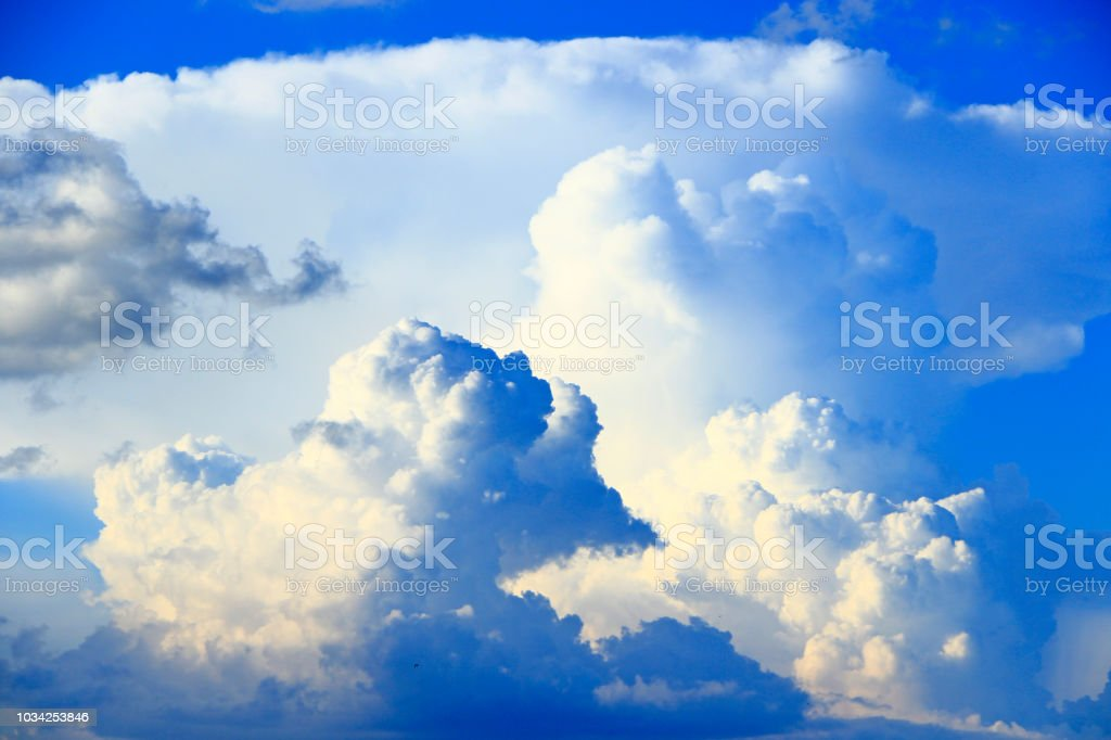 Big White Clouds On Blue Sky Heaven View Stock Photo - Download