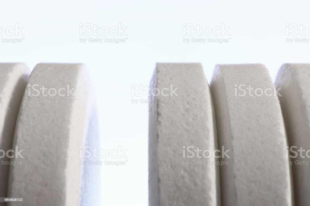 Big White Medicine Tablets Row. Pharmacy Pills Background. Macro Closeup. royalty-free stock photo