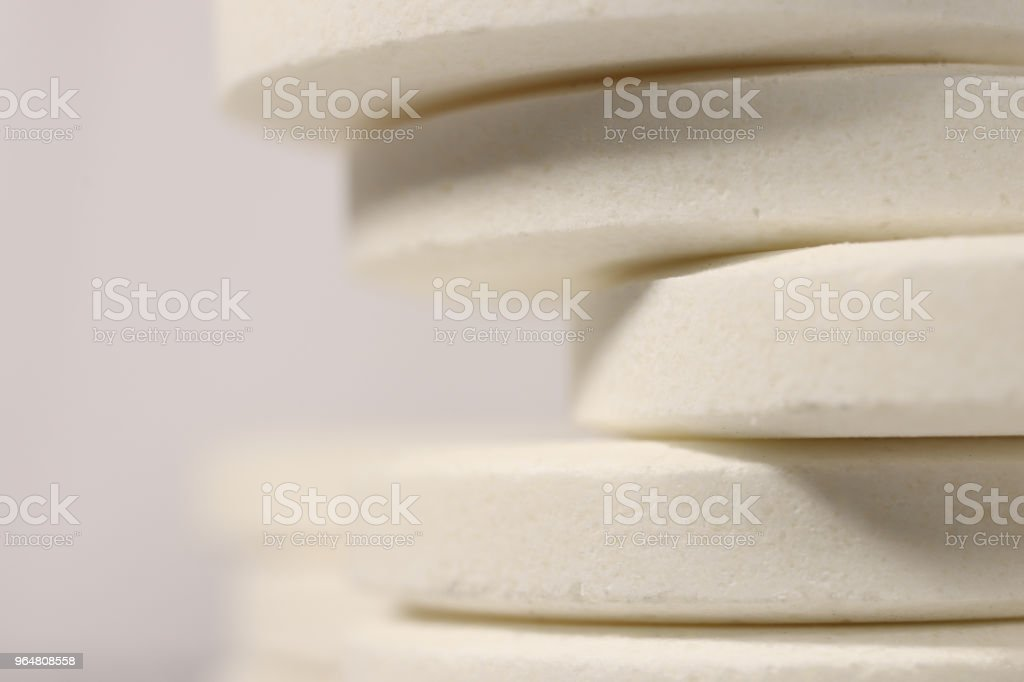 Big White Medicine Tablets Stack. Pharmacy Pills Background with Place for Text. Macro Closeup. royalty-free stock photo