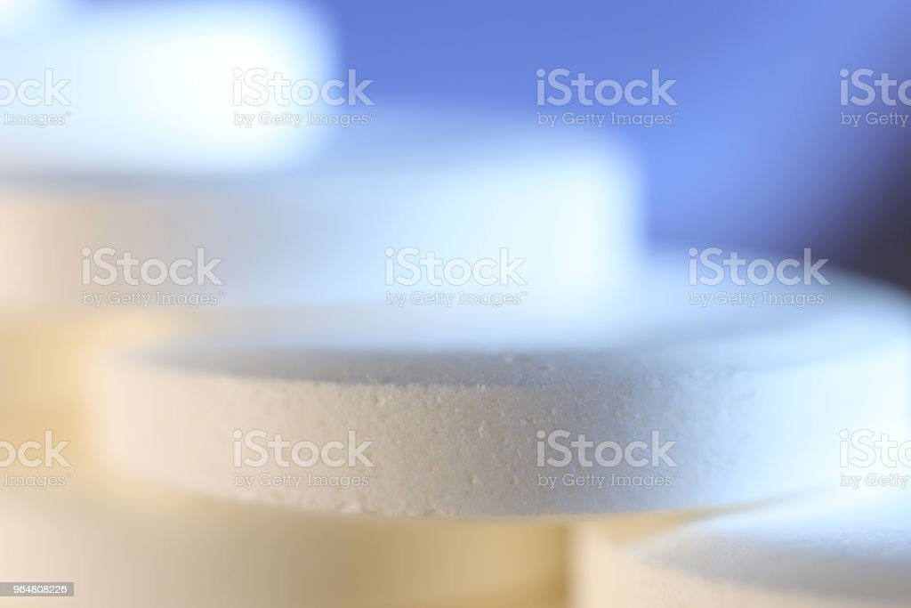 Big White Medicine Tablets Stairs. Pharmacy Pills Background. Macro Closeup. royalty-free stock photo