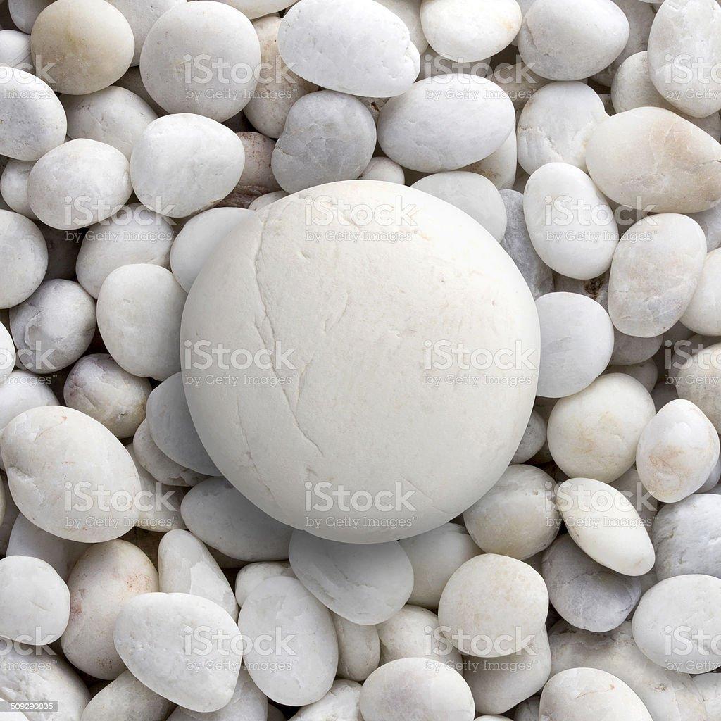 Big white rock laid on small round pebble, circle stone stock photo
