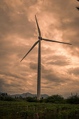 Huge windmill with dramatic sky with lots of clouds in the background