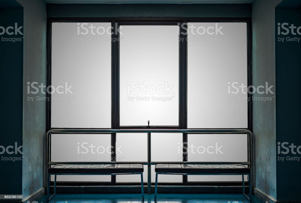 Big window and bench with old blue wall stock photo