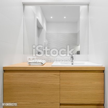 istock Big wooden drawers in bathroom 910655270