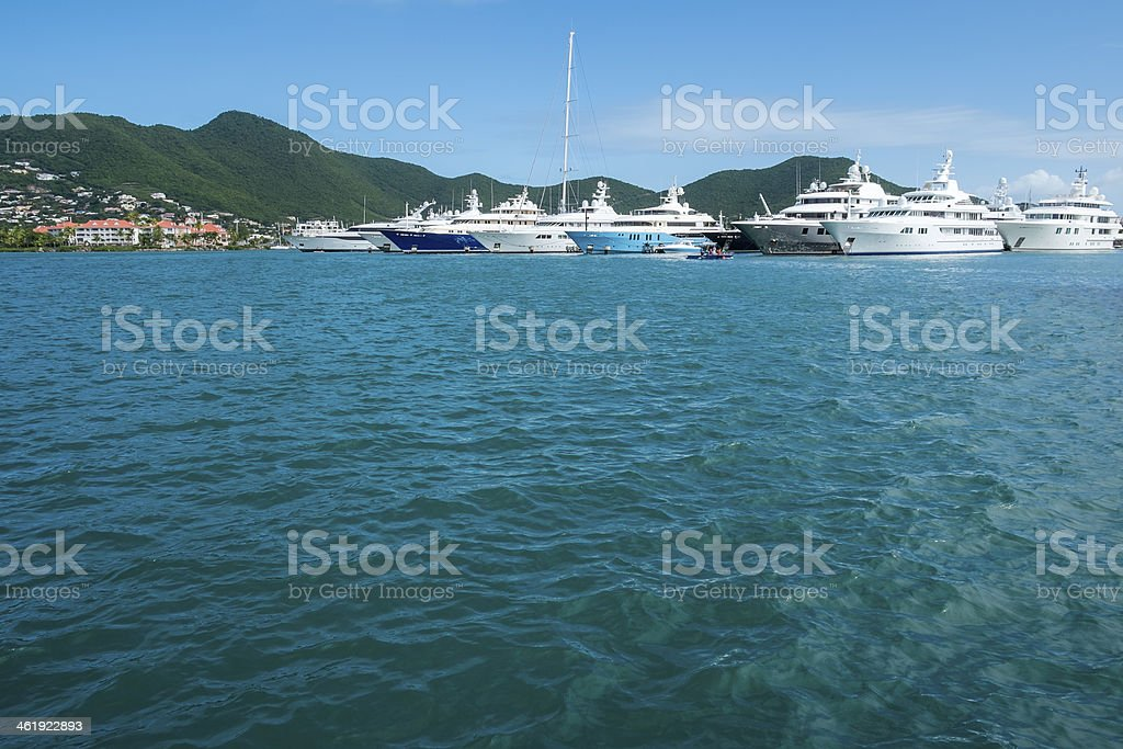 Big Yachts Anchored at a Bay in the Caribbean royalty-free stock photo