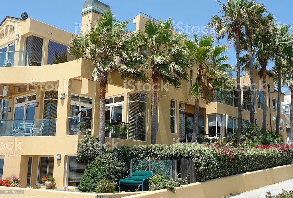 big yellow beach front california mansion royalty free stock photo