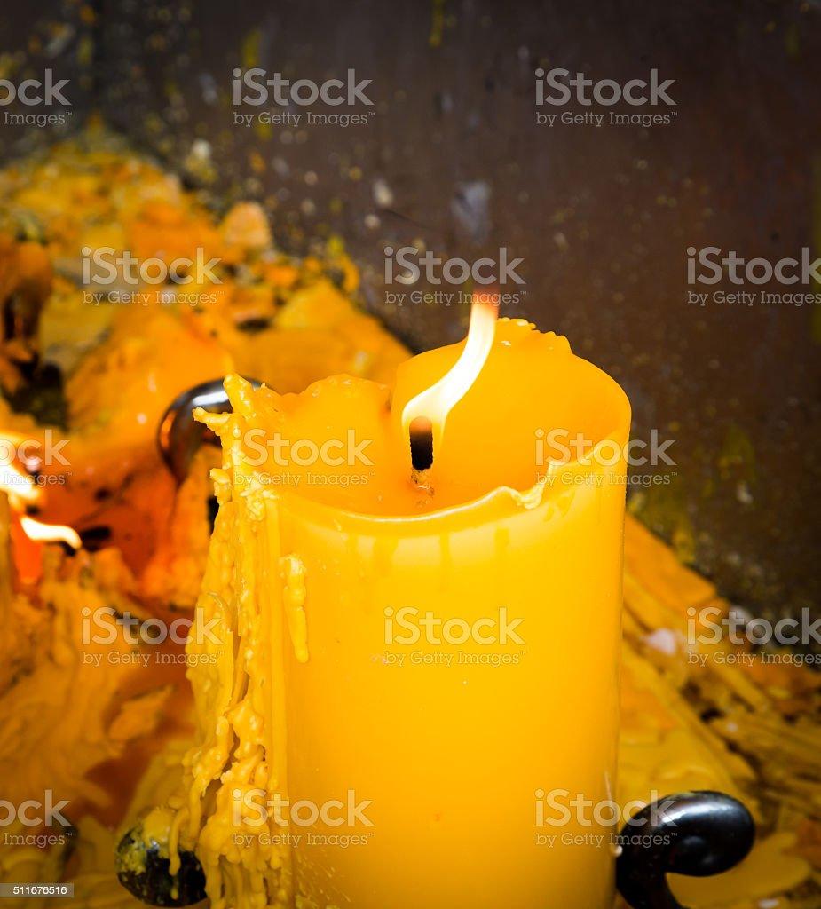 Big yellow candle stock photo
