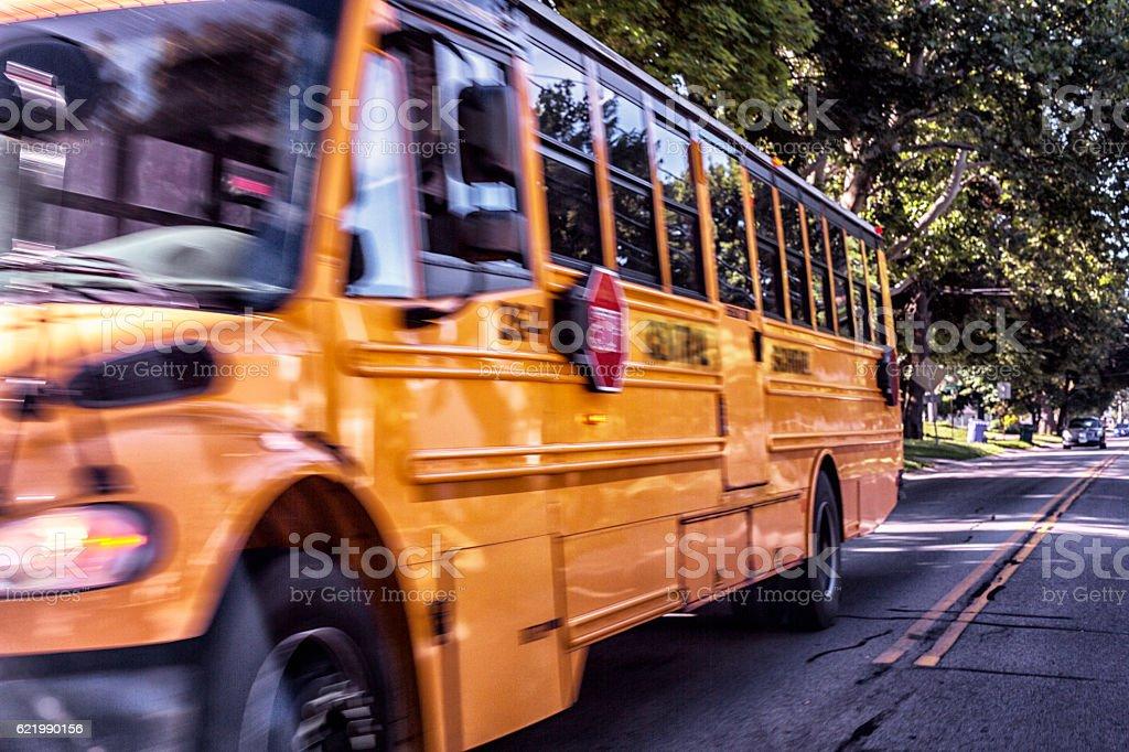 Big Yellow Motion Blur School Bus Passing on Suburban Street stock photo