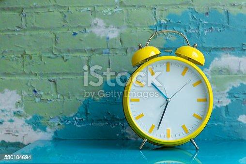 istock Big yellow retro style alarm clock 580104694