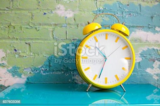 istock Big yellow retro style alarm clock 637603056