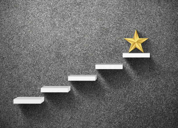 big yellow star on stair, business successful concept - incentivo foto e immagini stock