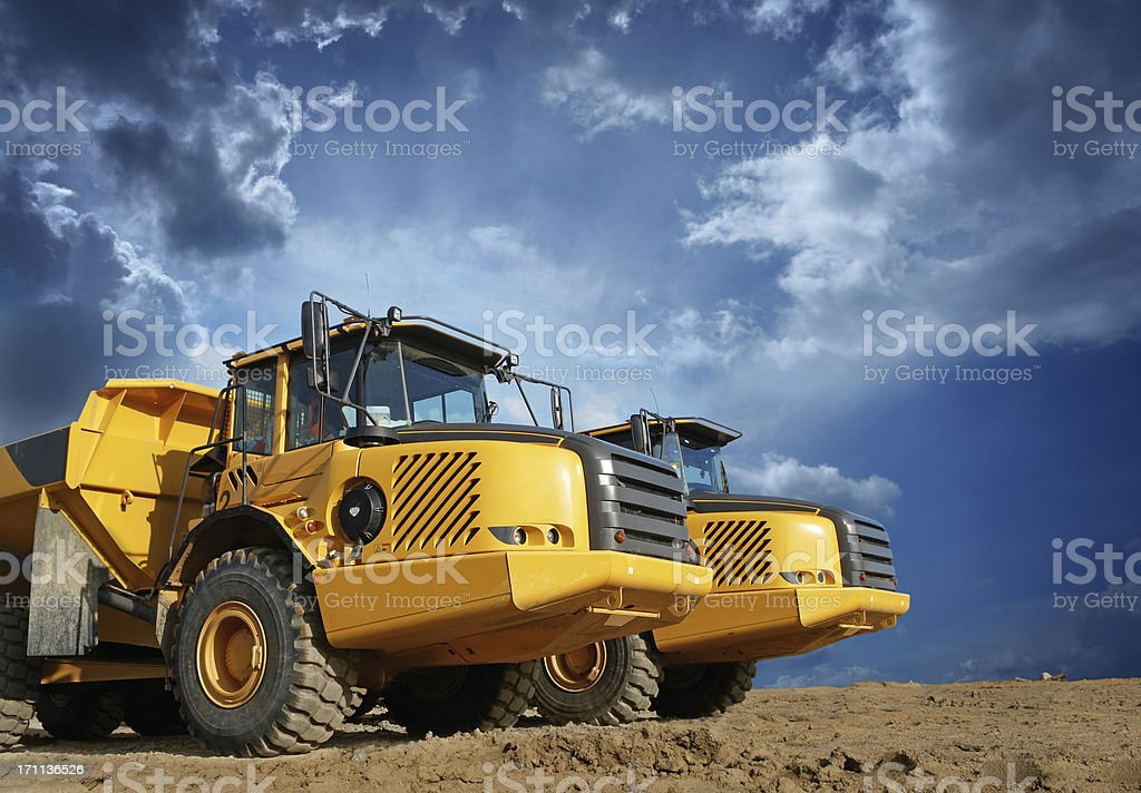 Big Yellow Trucks at Construction Site stock photo
