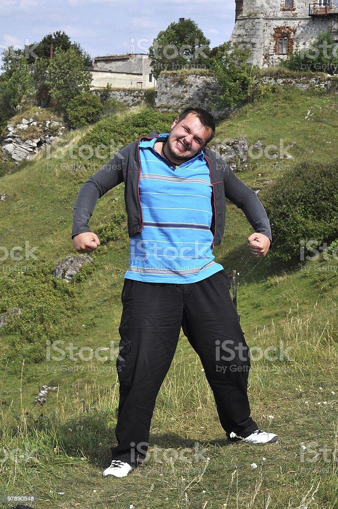 big young man wearing a small jacket royalty-free stock photo