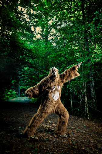bigfoot making a disco dancing step on the road