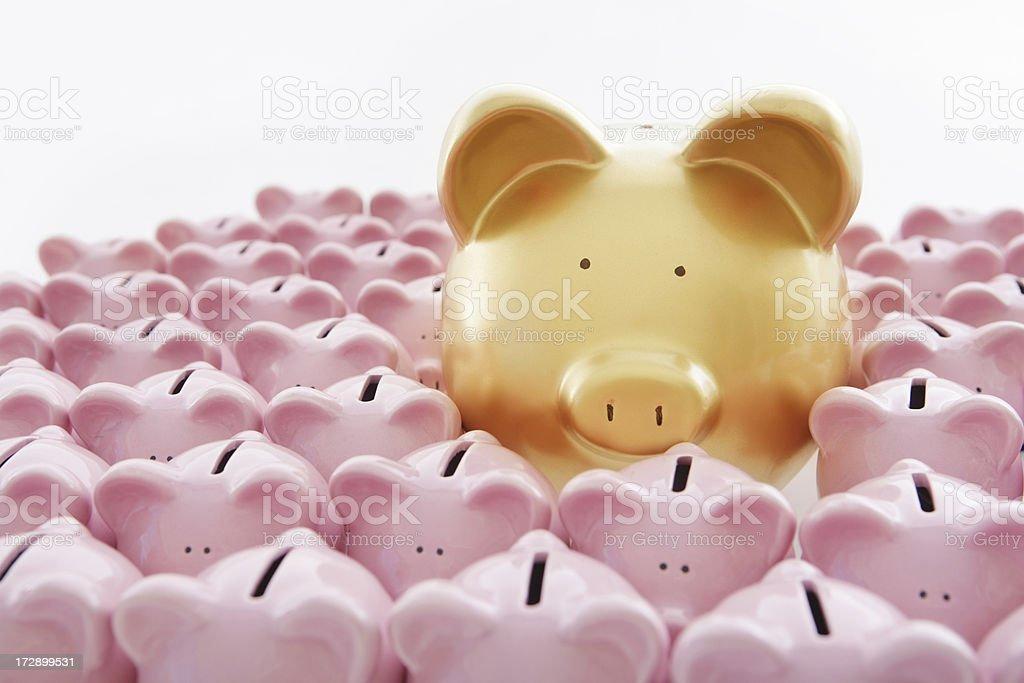 Bigger and Better Golden piggybank with lots of smaller pink piggybanks Banking Stock Photo