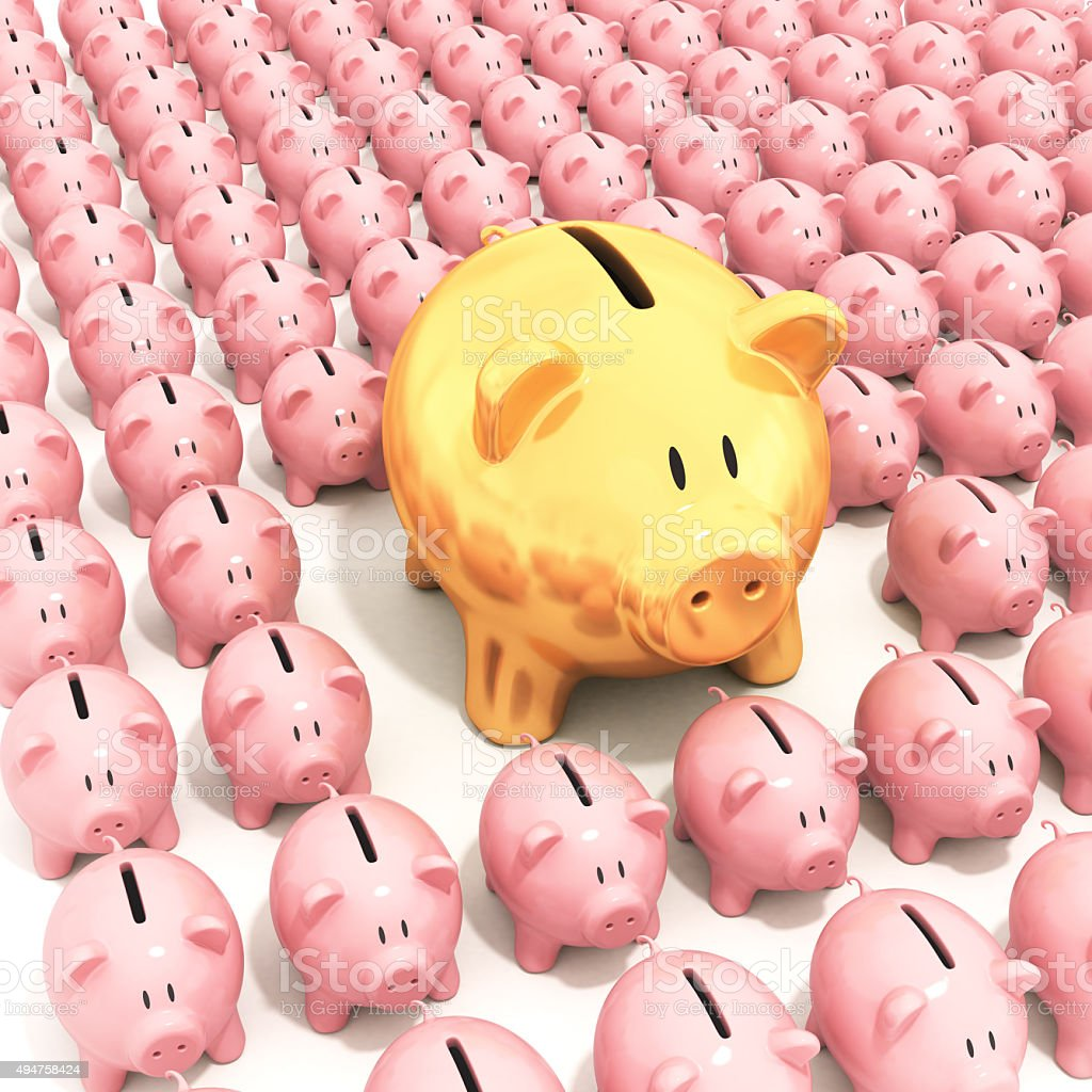 Bigger golden piggy bank standing stock photo
