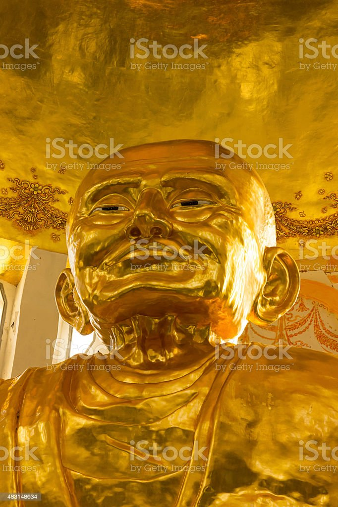 Biggest golden statue of monk stock photo