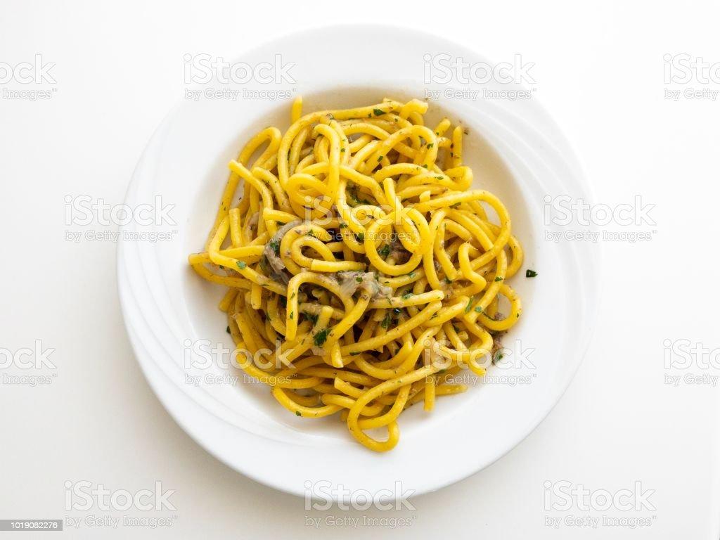 Bigoli(pasta) with anchovies sauce - foto stock