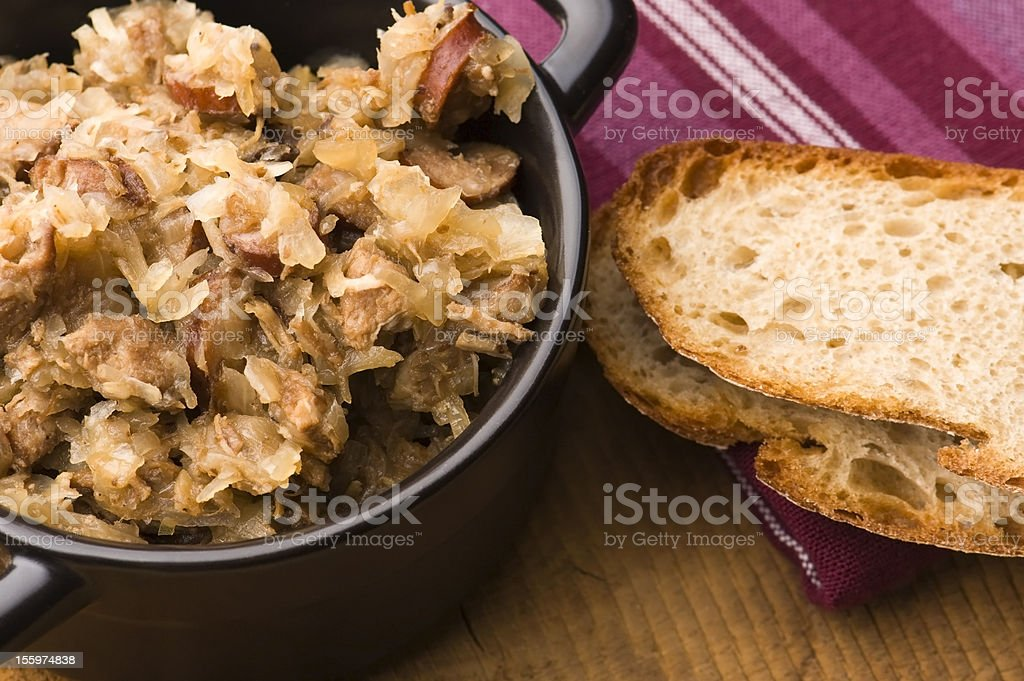 Bigos - traditional polish sauerkraut with mushrooms and plums royalty-free stock photo