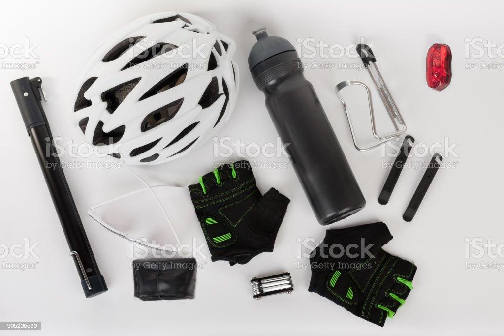 Bike accessories, bike helmet, bike gloves, eyeglasses, bottle in holder stock photo