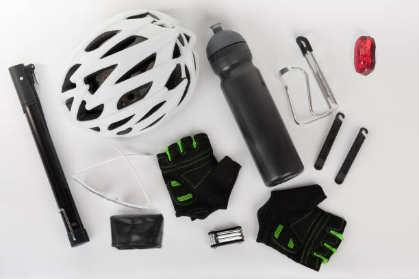 Bike accessories, bike helmet, bike gloves, eyeglasses, bottle in holder stock photo