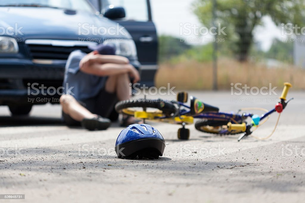 Bike accident and a boy stock photo