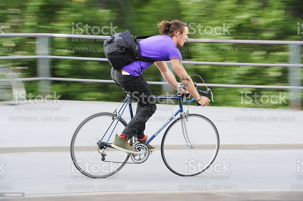 Bike against motion blurred green backgrund royalty-free stock photo