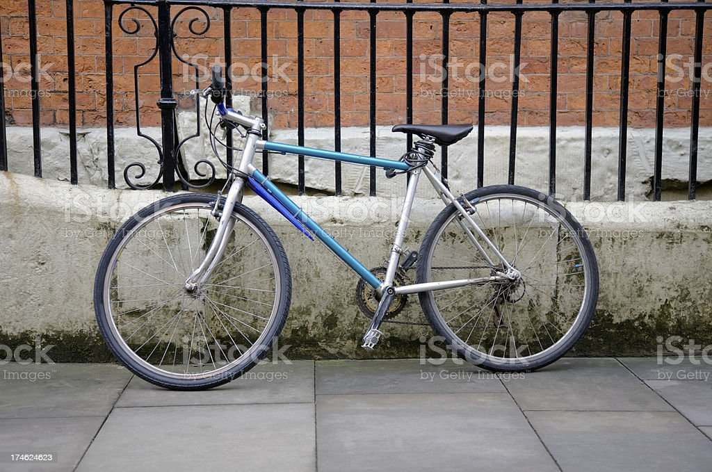 Bike Against Railings-See lightboxes below for more royalty-free stock photo