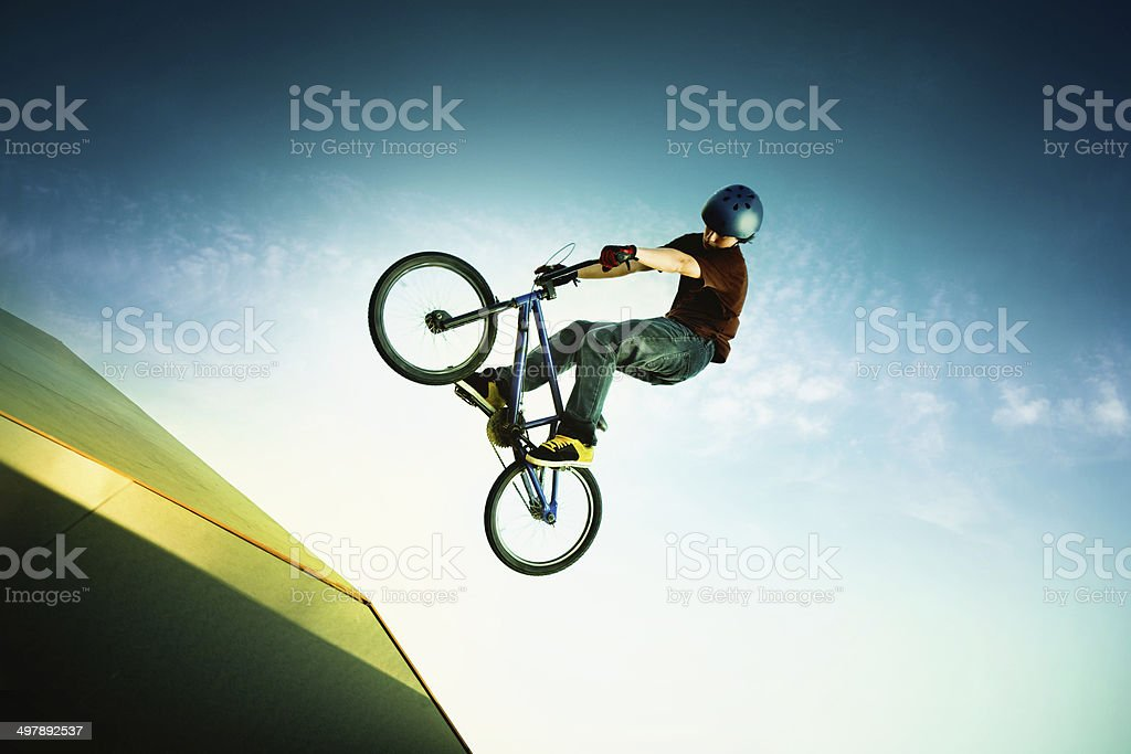 BMX bike artist jump on sport ramp stock photo