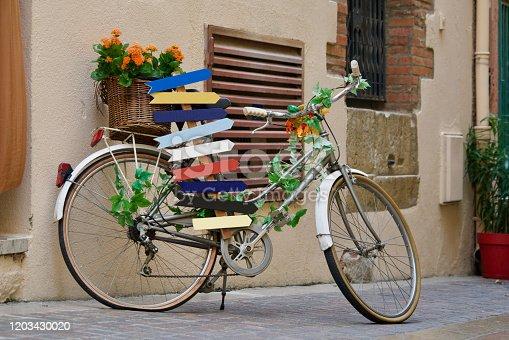 bike as destination board in a little road