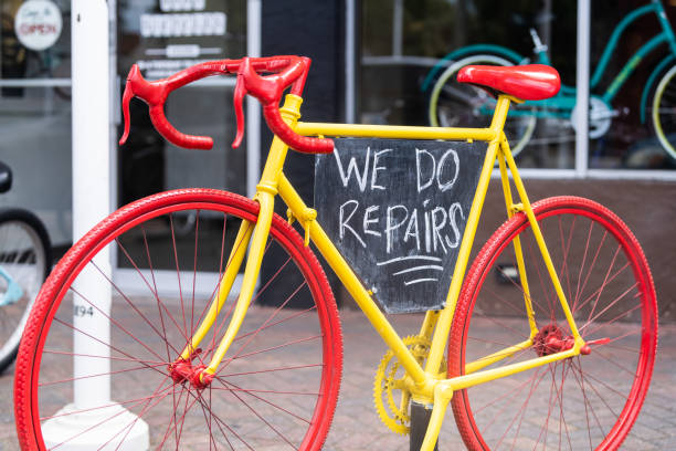 Bike bicycle repair shop store with advertisement sign outside outdoor on street sidewalk in Florida panhandle stock photo