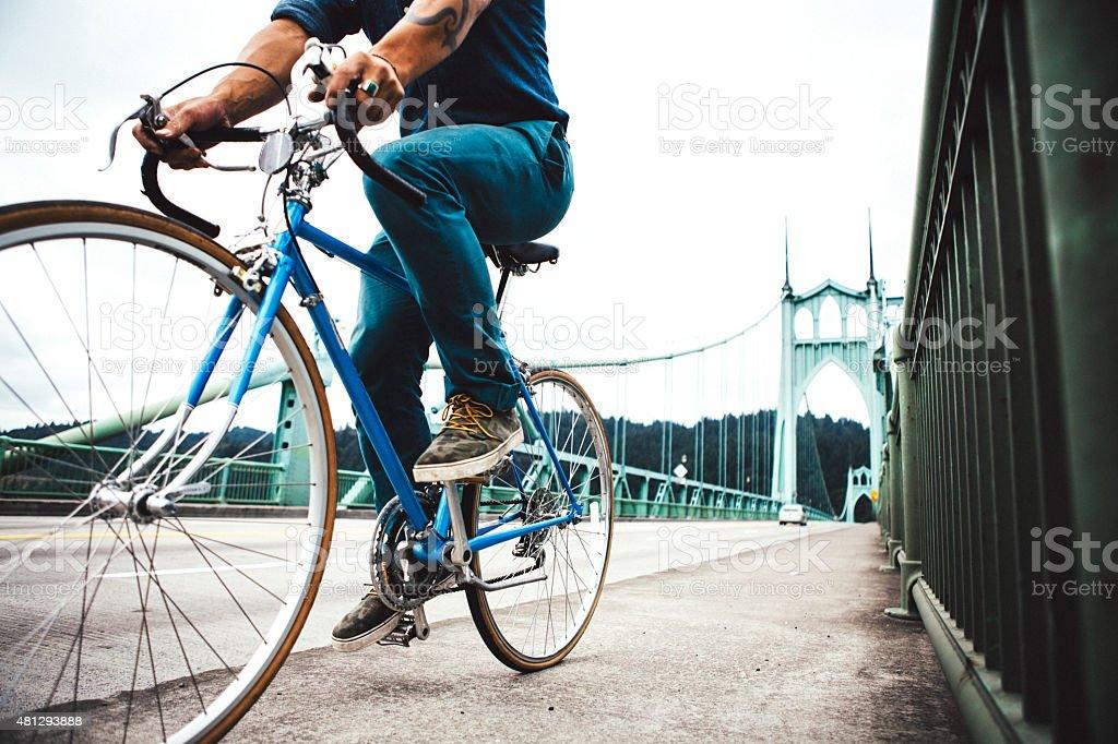 Bike Commuter in Portland Oregon on St Johns Bridge stock photo