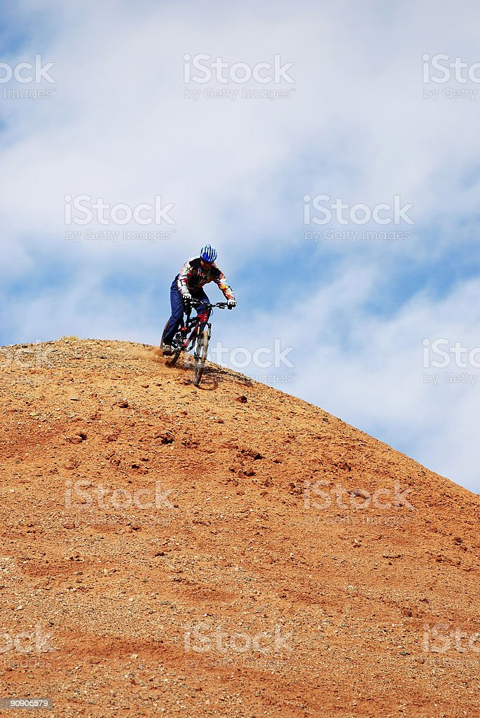Bike Downhill on red hill royalty-free stock photo