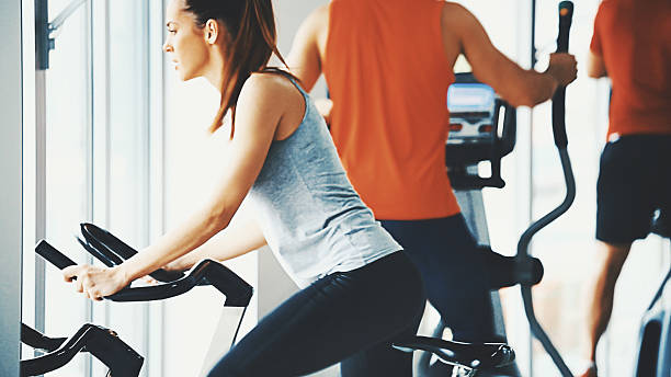 Bike exercising in a gym. stock photo