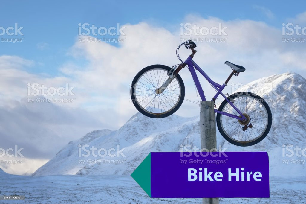 Bike hire sign in wilderness wild winter landscape for extreme sport cyclists in snow - Royalty-free Activity Stock Photo