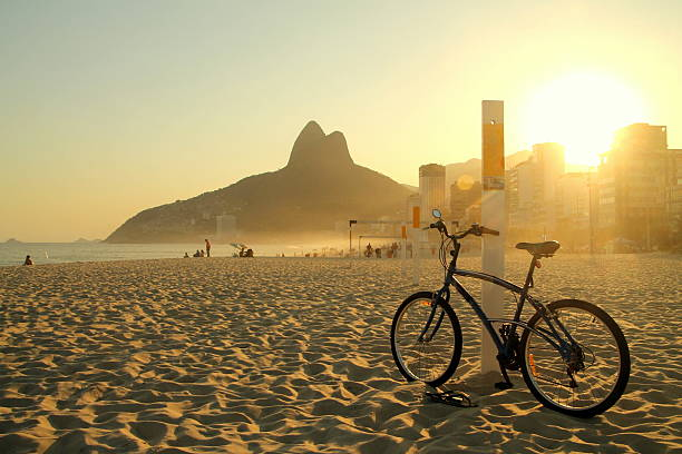 Bike in a great sunset at Ipanema beach stock photo