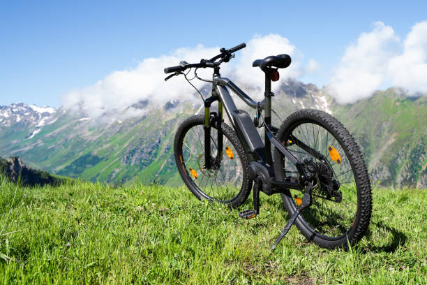 E Bike In Austria. Ebike Cycling E Bike In Austria. Ebike Cycling In Mountains electric bike stock pictures, royalty-free photos & images