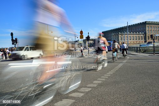 1060957508 istock photo Bike in city, motion blur 605974906