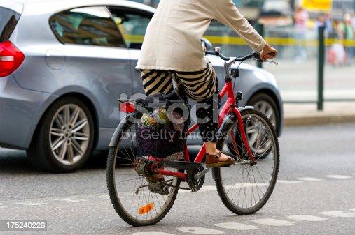 667005568istockphoto Bike in city traffic 175240226
