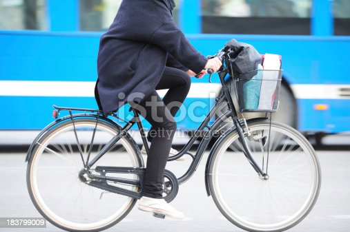 istock Bike in motion blurred traffic 183799009