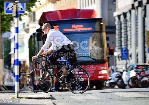 583973114istockphoto Bike in traffic 587231340