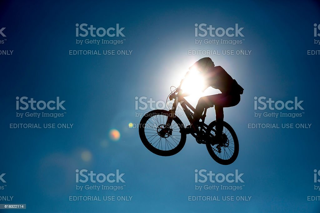 Bike jump silhouette stock photo