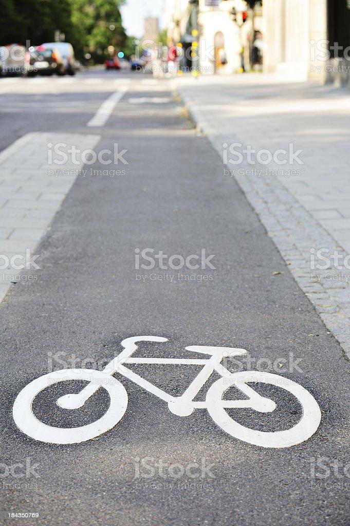 Bike lane and its symbol royalty-free stock photo