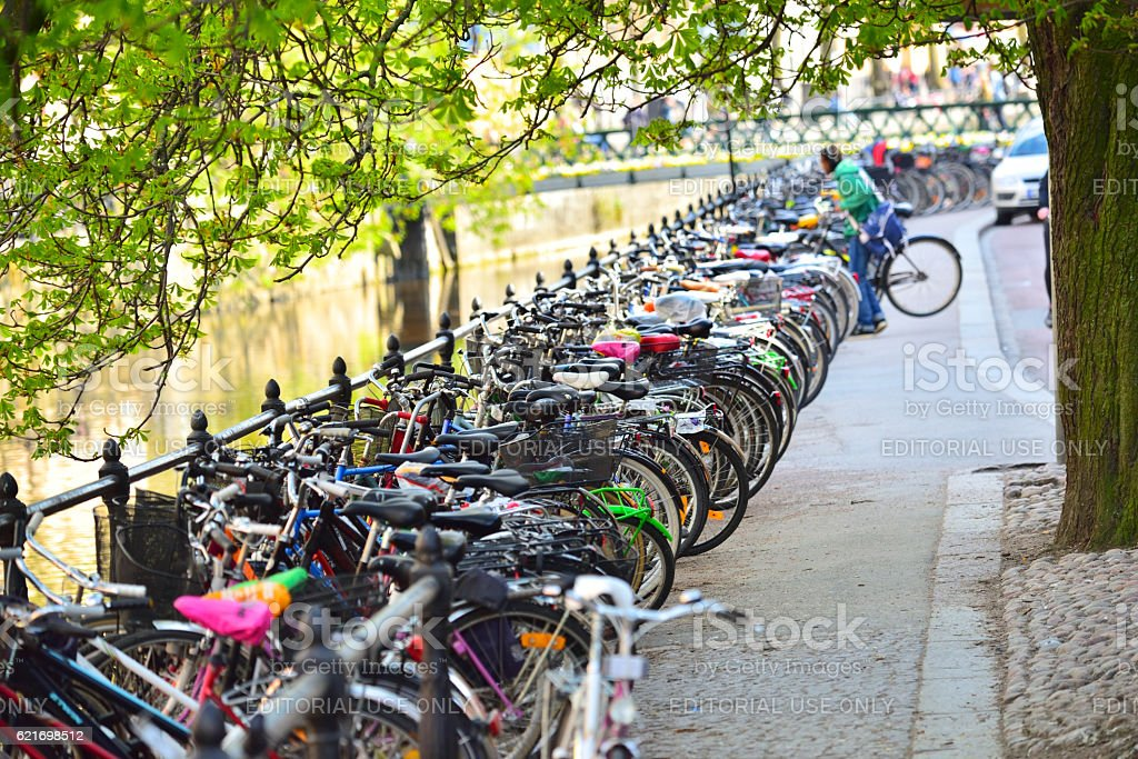 Bike lane and parked bikes in the city stock photo
