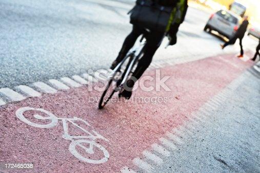 667005568istockphoto Bike lane and traffic 172465038