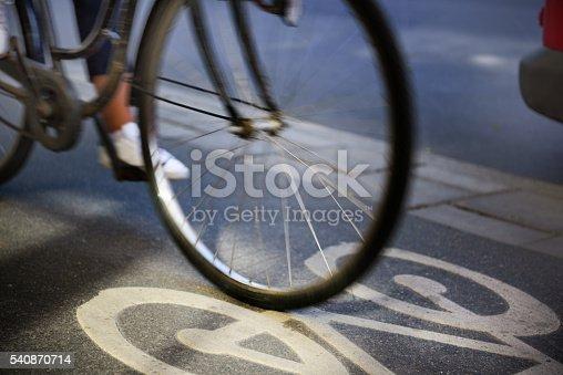 667005568 istock photo Bike lane and traffic 540870714